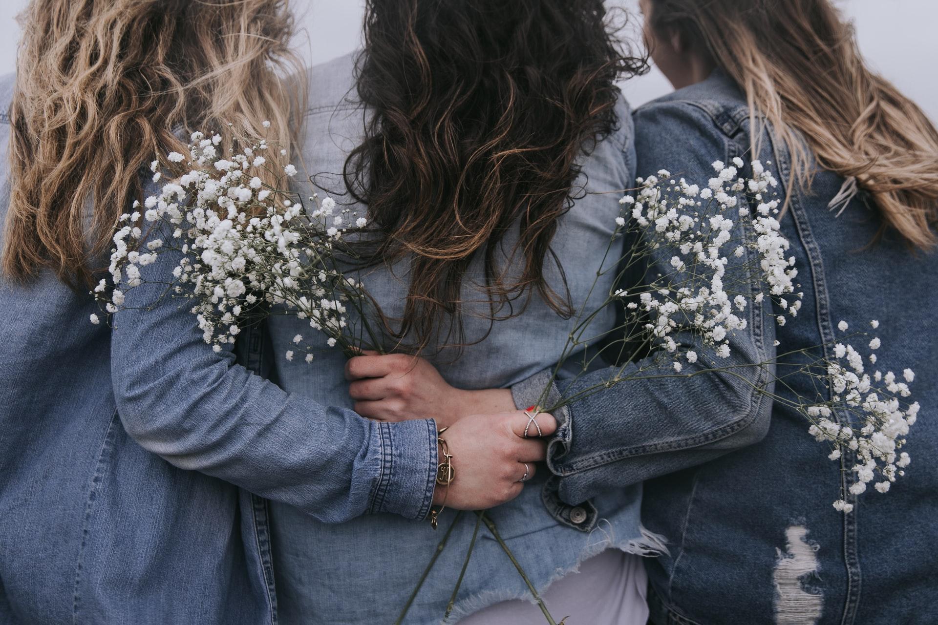 Back to back friends hugging
