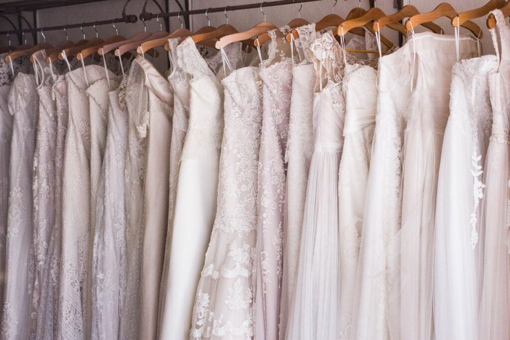 Wedding dresses on hangers in an atelier